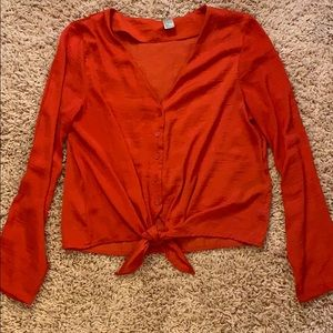 Red bottom tie blouse